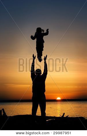 Father throws his infant child into the air