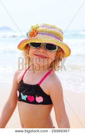 Portrait of funny little girl on sea