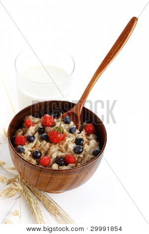 oat porridge with fresh berries on white isolated background. Healthy eating.