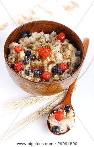 oat porridge with fresh berries isolated on a white background