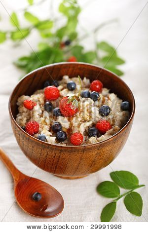 oat porridge with fresh berry. Healthy eating.