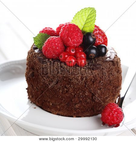 beautiful chocolate cake with fresh berry on white isolated background
