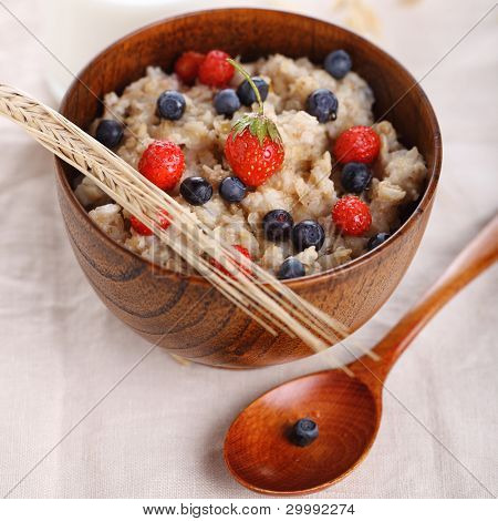 oat porridge with fresh berries. Healthy eating.