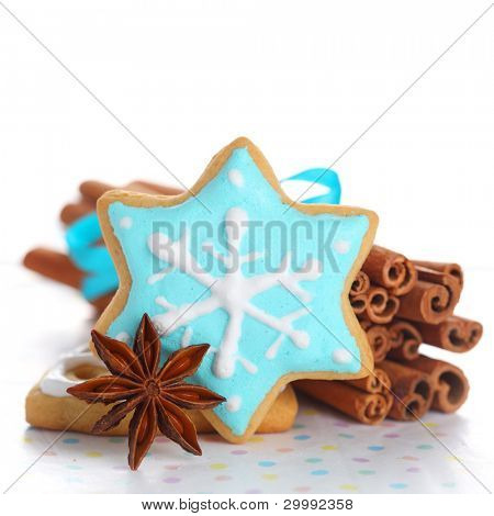 Christmas cookies with cinnamon and anise on white isolated background