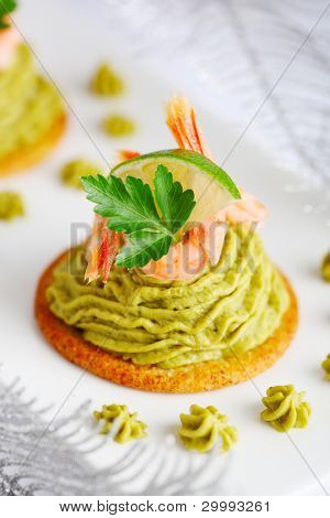 Avocado cream and prawns on crackers for Christmas