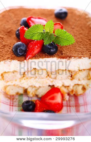 Tiramisu - classical dessert with strawberry and mint