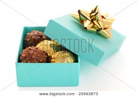 Gift box with chocolate truffle on white background isolated