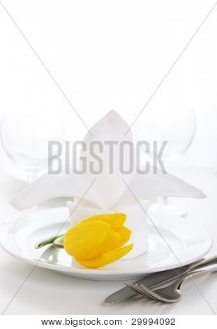 White napkin with tulip on white plate- Spring time