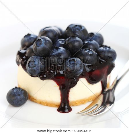 Cheesecake with fresh blueberries on white isolated background