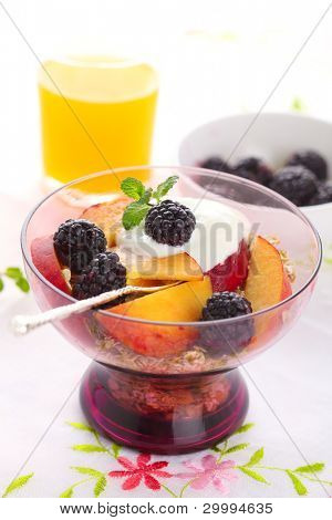 healthy breakfast -muesli with fresh berries, fruit and yogurt