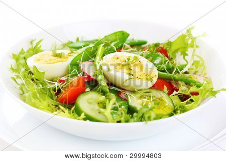 salad of tomatoes, cucumbers, asparagus, young green peas dressed with olive oil and watercress salad