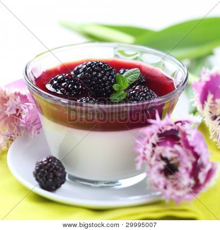 dessert with blackberries and cream