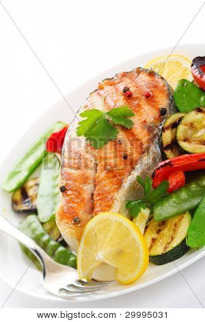 grilled salmon with vegetables on white plate