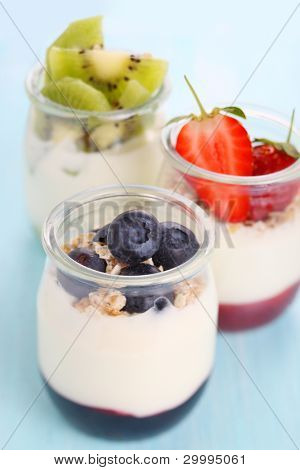 Natural yogurt with jam and fresh berries (strawberry, blueberry, kiwi)