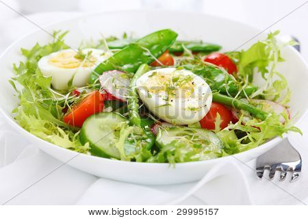 Vegetable salad of tomatoes, cucumbers, asparagus and young green peas