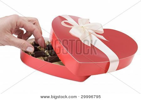Woman's Hand Taking Chocolate Candy