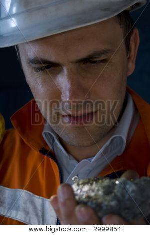Chief Miner Inspecting Mineral