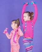 Healthy Upbringing. Sporty Babies. Following Her Sister. Girls Cute Kid Exercising With Dumbbells. M poster