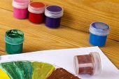 Childrens Creativity. Drawing Paints. 12 Colors Of Paint. Color Palette. Paints On A Wooden Backgrou poster