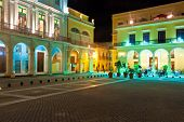 La Plaza Vieja or Old Square , a well known touristic landmark in Old Havana illuminated at night