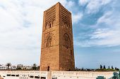 View Of Tour Hassan Tower Against Blue Sky - Hassan Tower Or Tour Hassan Is The Minaret Of An Incomp poster