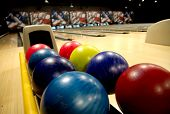 stock photo of bowling ball  - Bowling balls in the rack at a bowling alley - JPG