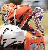 Picture Of Lacrosse Players During A Time-out poster