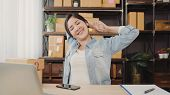 Asian Entrepreneur Business Woman Stretching Her Body After Answer Customer Question, Female Owner O poster
