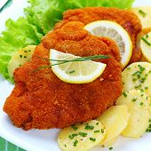 stock photo of wieners  - Wiener Schnitzel with potato salad - JPG
