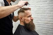 Master Cuts Hair And Beard Of Men In The Barbershop, Hairdresser Makes Hairstyle For A Young Man poster