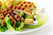 picture of caesar salad  - Caesar Salad with grilled chicken on white plate - JPG