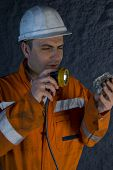 image of gold mine  - Engineer inspecting the rock mineral stock photo - JPG