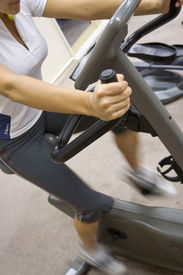 foto of exercise bike  - Perspective shot of a young woman on excercise bike in the gym