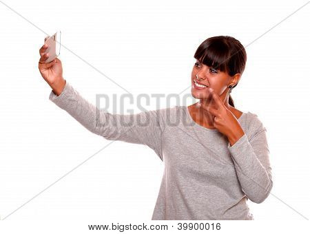 Stylish Young Woman Taking A Photo With Cellphone