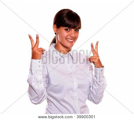 Young Woman Holding Up Two Fingers In Victory Sign