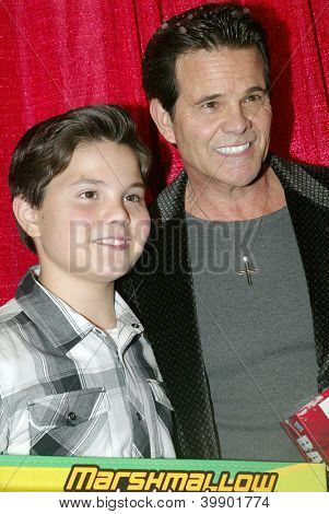 UNIVERSAL CITY - DEC. 4: Zach Callison and Ed Callison arrives at publicist Mike Arnoldi's birthday celebration & Britticares Toy Drive for Children's Hospital on Dec. 4, 2012 in Universal City, CA.