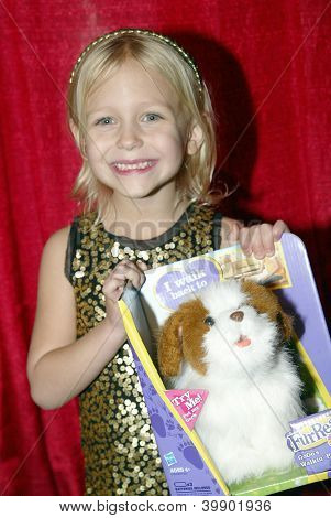 UNIVERSAL CITY - DEC. 4: Alyvia Alyn Lind arrives at publicist Mike Arnoldi's birthday celebration & Britticares Toy Drive for Children's Hospital on Dec. 4, 2012 in Universal City, CA.
