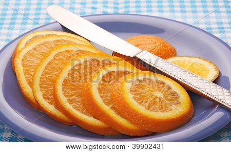 Slices Of Orange On A Blue Plate.
