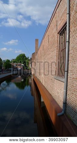 red bricks building on canal