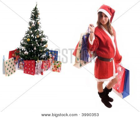 Young Santa Girl Close To A Christmas Tree
