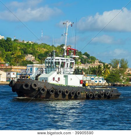 White tugboat sailing in the bay of Havana