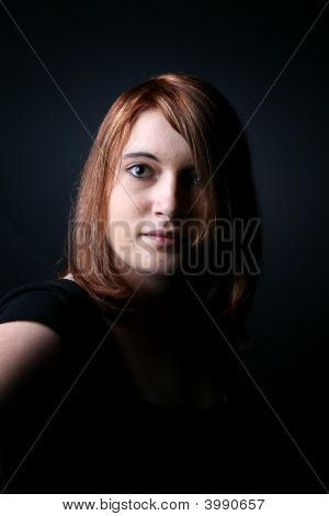 Dramatically Lit Portrait Of A Red Haired Teen