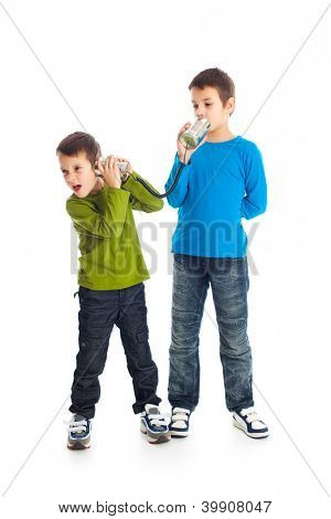 Two boys calling tin can phone. Studio shot.