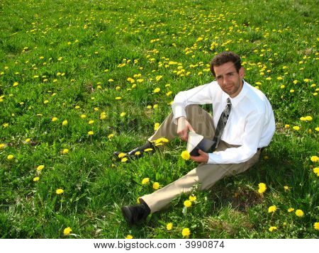 Businessman On The Lawn