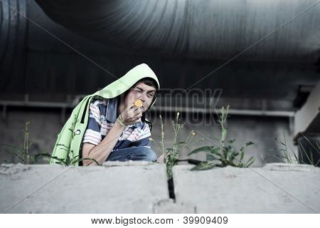 Crazy young man smelling a flower