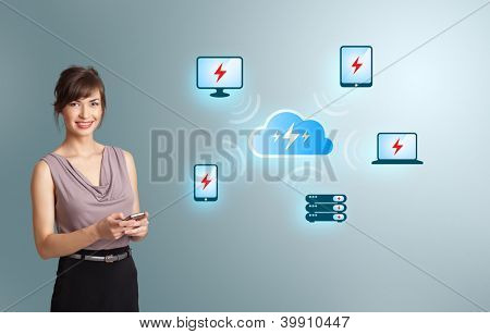 Beautiful young woman holding a phone with cloud computing network