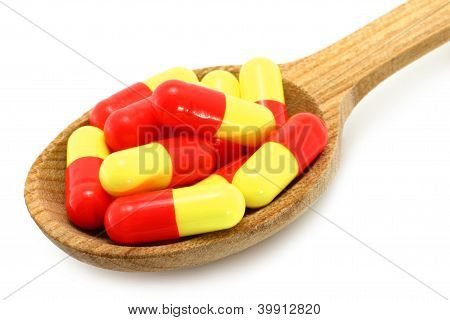 Wooden spoon with pills