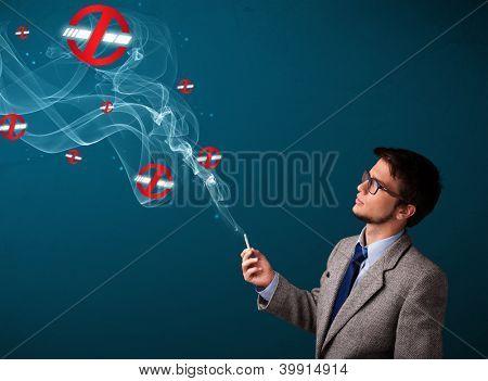 Cigarro perigoso de atraente jovem fumar sem sinais de fumo