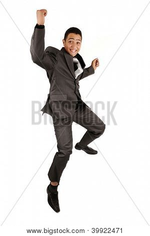 Portrait of a happy businessman jumping in air against isolated white background