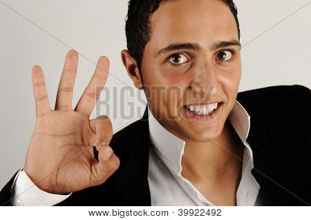 Closeup of a happy man showing ok sign